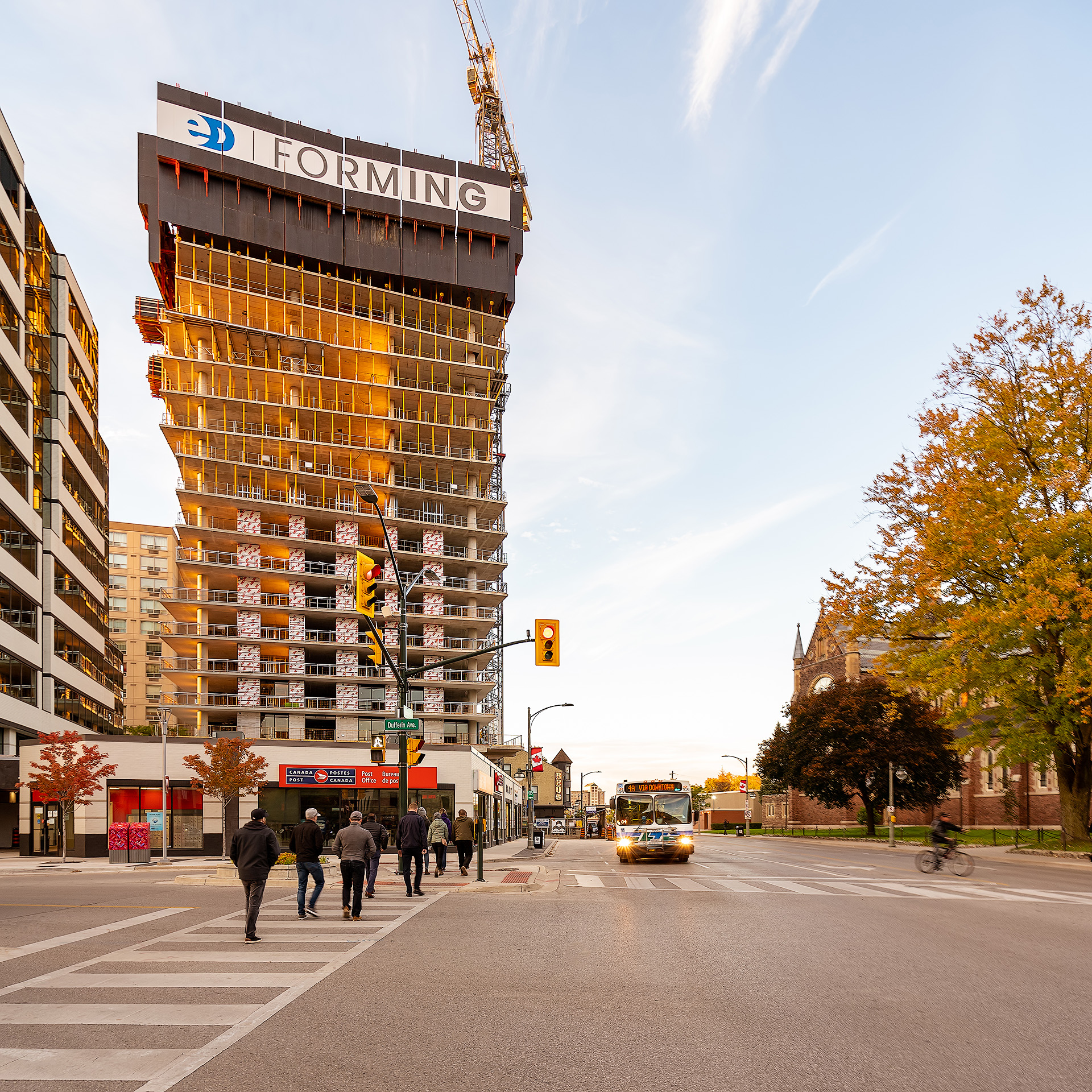 People crossing Richmond Street at Dufferin Ave with Construction of One Richmond Row in the Background