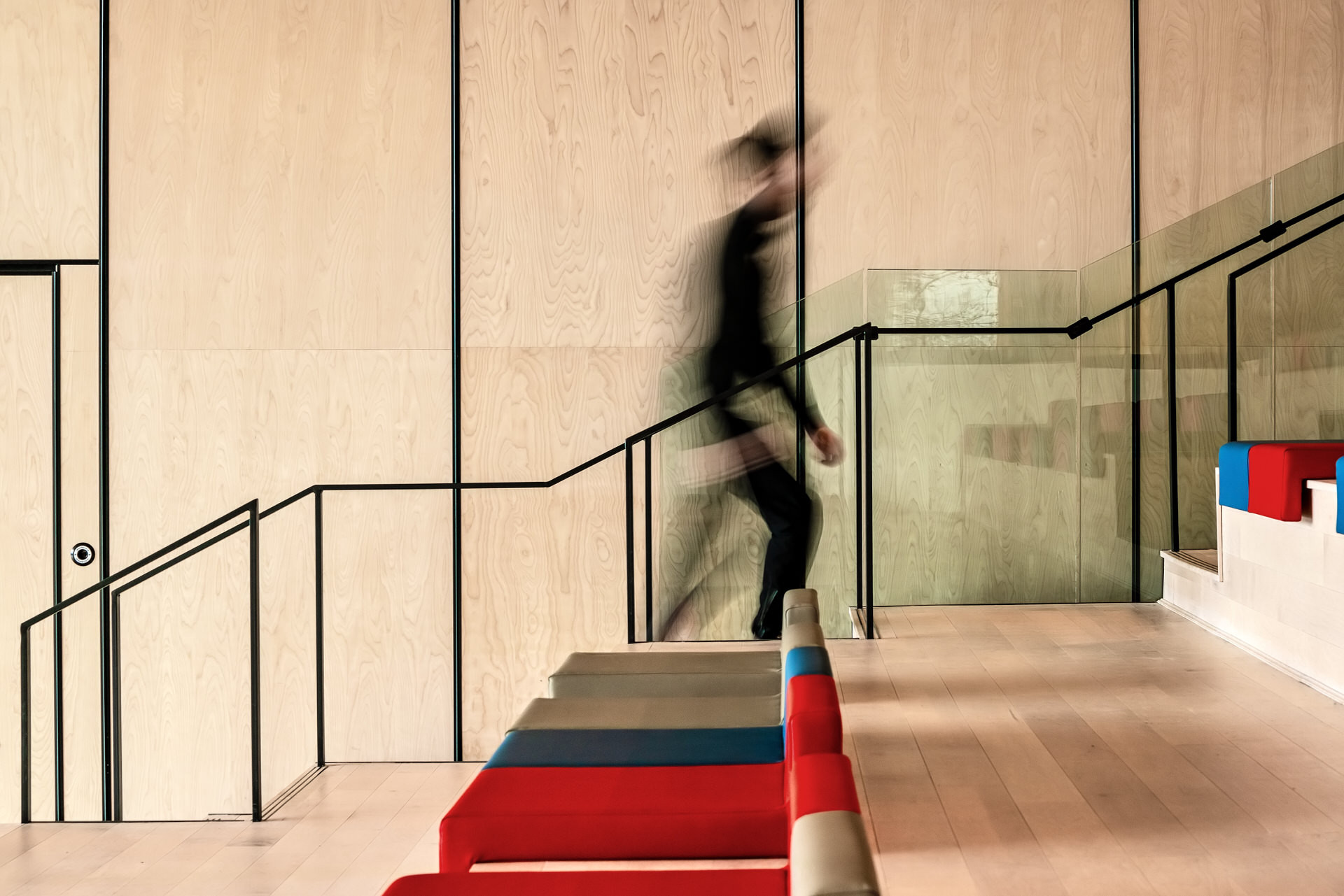 Person using stairs inside the Centre at the Forks